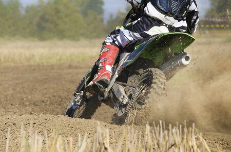 supercross: Motocross racer accelerating speed in track