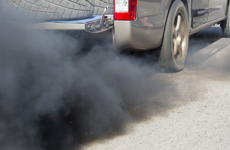 smog: Air pollution from vehicle exhaust pipe on road