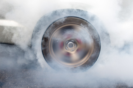 burnout: race car burns rubber off its tires in preparation for the race