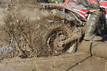 enduro: Enduro wheel in muddy track ,climbing log obstacle Stock Photo