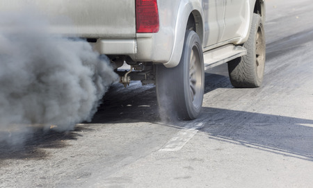 exhaust pipe: Air pollution from vehicle exhaust pipe on road