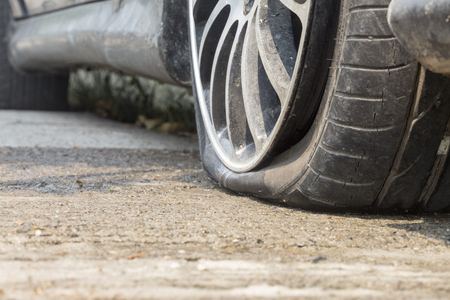 puncture: Car flat tire on road