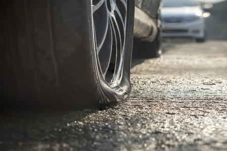 tire: Car flat tire in rainy day Stock Photo