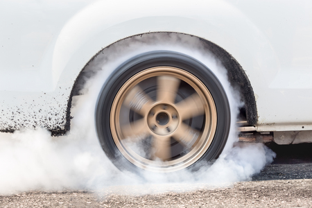 dragster: Dragster Car Burn Out Rear Tyres With Smoke