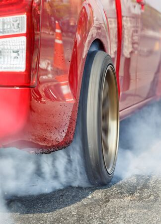 drag race: Drag racing car burns  tire in preparation for the race Stock Photo