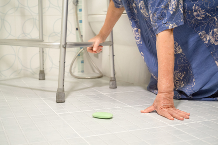 slippery: elderly falling in bathroom because slippery surfaces