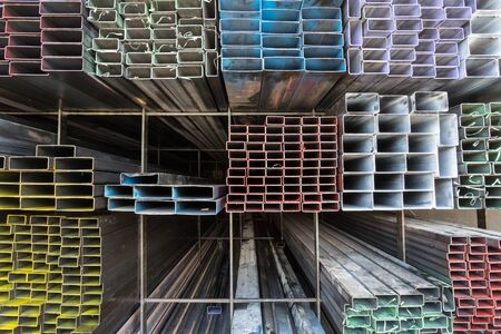 Steel pipe and steel beam and construction material on shelf in warehouse