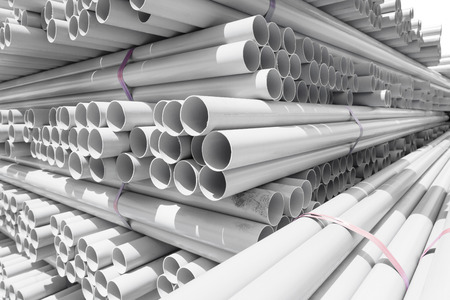pvc: PVC pipes stacked in warehouse