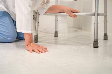 fall arrest: Retirement woman fell down in a restroom