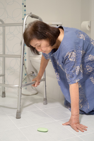 elderly falling in bathroom because slippery surfaces Banco de Imagens - 61238031
