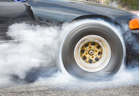 dragster: Drag racing car burns rubber off its tires in preparation for the race Stock Photo