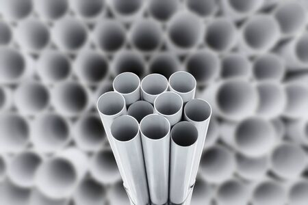 culvert: PVC pipes stacked in warehouse.