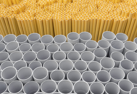 culvert: PVC pipes stacked in warehouse, Yellow pipe for electrical wiring and telephone cable conduit.