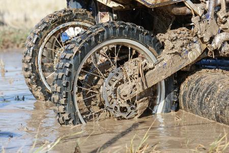 enduro: Enduro wheel in muddy track ,climb wood obstacle Stock Photo