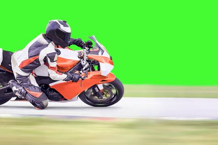 cornering: Motorcycle leaning into a fast corner on highway
