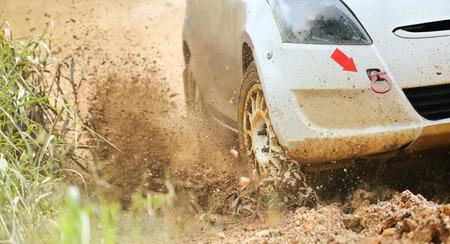 muddy: Rally car in muddy road