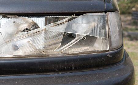 headlamp: damaged car headlamp after collision