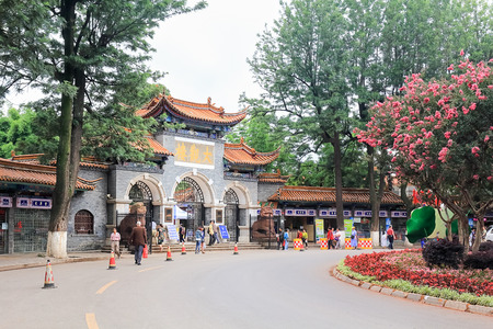 KUNMING, CHINA - JUN 28 : Daguan park entrance. The famous park encompasses 300 acres of ponds, ornamental rock gardens, pavilions, meandering paths and an amusement park. June 28, 2015 in Kunming, Yunnan,China.