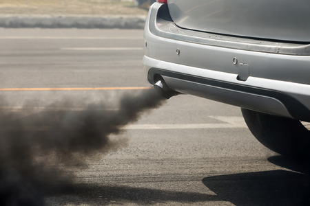 Air pollution from vehicle exhaust pipe on road Stok Fotoğraf - 66964403