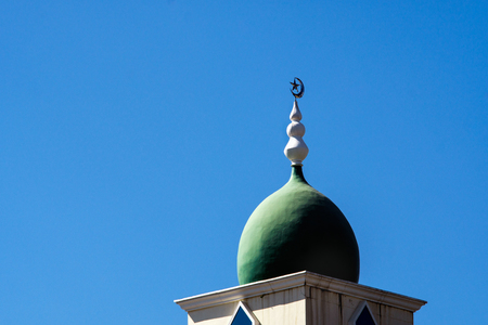 minaret: closeup of the top of a mosque minaret with a cupola dome