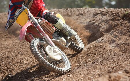 dirt: motocross speed in track Stock Photo