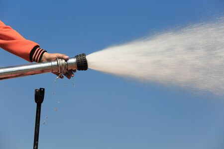 blasting: Spray water on truck during fire training in the industry Stock Photo