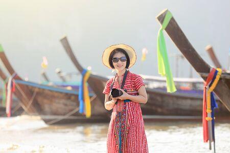 outstretching: Tourist woman enjoying travel vacation in Krabi, Thailand. Stock Photo