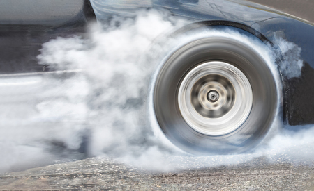 burnout: Drag racing car burns rubber off its tires in preparation for the race Stock Photo