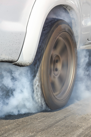 dragstrip: Dragster Car Burn Out Rear Tyre With Smoke Stock Photo