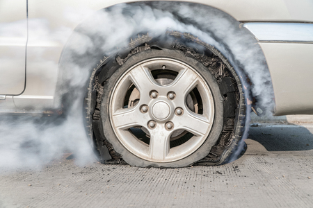 burst tire on the road Stock Photo - 75783375