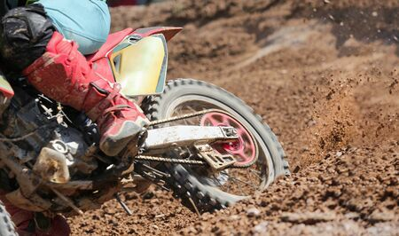 dirt: Motocross rider increase speed in track Stock Photo