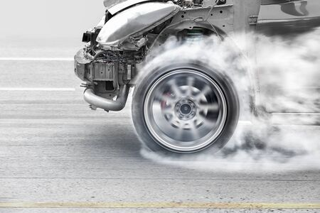 wheelspin: race car burns rubber off its tires in preparation for the race