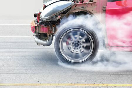 dragster: race car burns rubber off its tires in preparation for the race