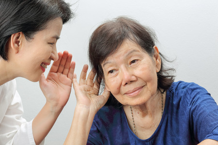 Asian seniors woman hearing loss , Hard of hearing