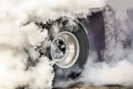 wheelspin: Drag racing car burns off its tires for the race