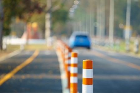 Flexible traffic bollard for bike lane.