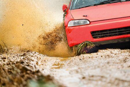 Rally racing car in dirt track