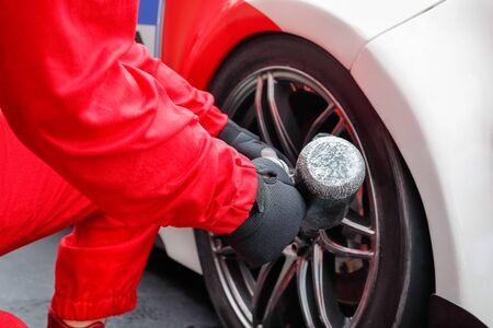 impact wrench: Auto mechanic changing car wheel