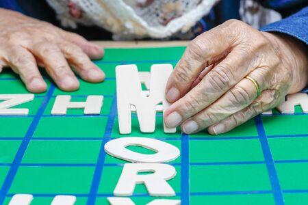 Crosswords for Elderly ,help improve memory & brain Stock Photo