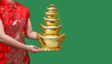 Chinese new year gold ingots (qian) with blessing text mean happy ,healthy and wealth on green screen, Imagens