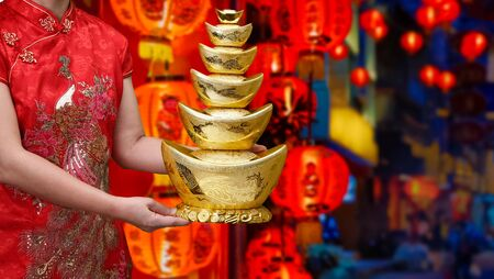 Chinese new year gold ingots (qian) with blessing text mean happy ,healthy and wealth in china town. Stock Photo