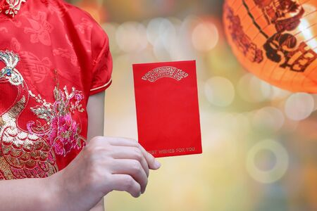 chinese woman holding new year red envelope or hong bao