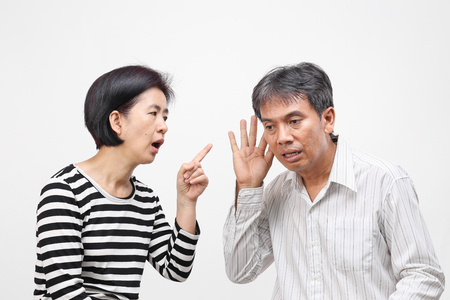 A woman pointing her finger and blaming her husband Stock Photo