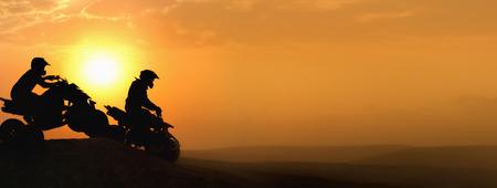 Silhouette ATV or Quad bikes Jump in sunset. Imagens
