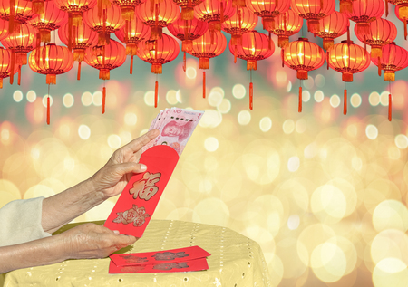 Red envelope chinese new year or hong bao , text on envelope meaning good luck Stock Photo