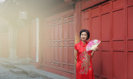 Female Tourist with Chinese Traditional Clothing in Lijiang Old town ,Yunnan, China.