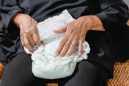 elderly woman changing diaper Standard-Bild