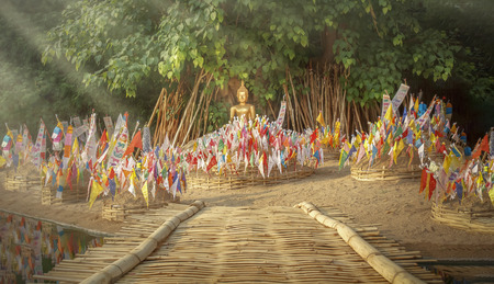 Tung or Northern thai traditional flag on sand pagoda in songkran festival.