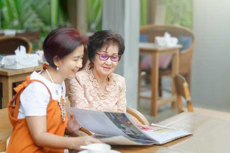Mom and daughter choice the restaurant menu together Stock Photo