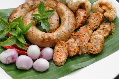 Northern Thai Sausage or Sai-Aua , filled with chopped lemongrass, galangal, kaffir lime, coriander and red curry paste.